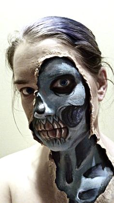 Skull makeup for Halloween. Ripped skin. ManaArt Face and Body Painting ManaArtOnline.com