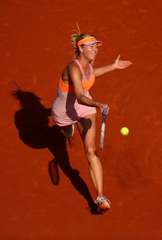 Maria Sharapova - 2014 French Open - Day Fourteen. Maria Sharapova of Russia returns a shot during her women's singles final match against Simona Halep of Romania on day fourteen of the French Open at Roland Garros on June 7, 2014 in Paris, France.