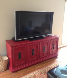 Nothing like a vintage, red console to spruce up a family room.  We gave this piece makeover for Tripp and his family.  You can see the before picture here:  https://www.facebook.com/photo.php?fbid=423855454366476=a.158877067530984.41862.141347889283902=3