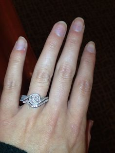 My beautiful Tolkowsky engagement ring with matching band. I don't know how my fiancée found it but there IS a band for this ring! We were dreading the cost of having it custom made, but we were able to order in the band!