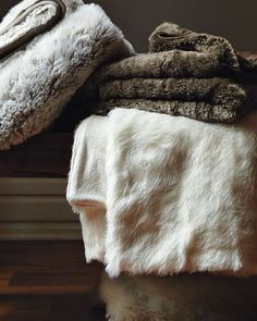 Faux-Fur Throw : Remodelista in white with a dark grey duvet Faux Fur Blanket, Faux Fur Throw, Grey Duvet, Fur Throw Pillows, Throw Blankets, Trellis Pattern, Sheepskin Rug, Textiles, Beige Carpet