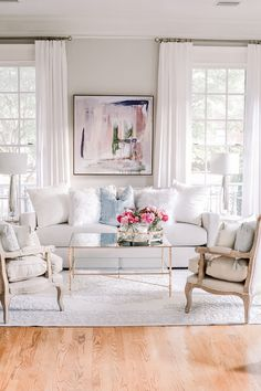 Transitional glam formal living room Abstract art blush blue, white and gold living room, antique gold coffee table, gray French Chairs, Glam Living Room, Formal Living Rooms, Living Room Decor, White Couch Living Room, French Living Rooms, White Couches, Living Room Inspiration, Hang Curtains, Linen Curtains