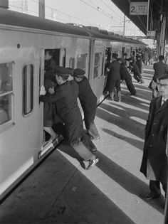 Tokyo train passengers being loaded up in 1962