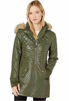 Women's Olive Green Quilted Puffer Jacket With Hood by Michael Kors. Olive Green Quilted Nylon Hooded Puffer Parka Jacket Women's. The quilted nylon puffer jacket features a removable hoodie with a faux-fur trim for versatile wear. #PufferCoats #WinterCoats #MichaelKors