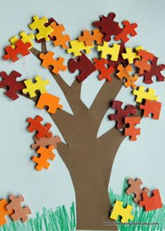 Paint the puzzle pieces for fall display