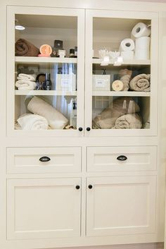 Built in linen closet with glass front cabinets - great way to show off your gorgeous linens!  #wecanbuildthat