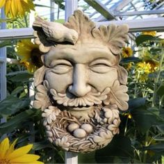 A sprightly take on the traditional green man, this joyful botanical face is eager to welcome a new family to the neighborhood! He beams with pride at his leafy beard, which has been fashioned into a