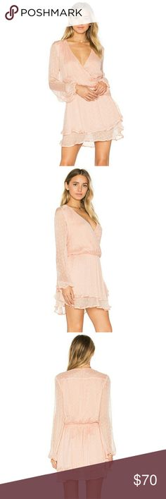 """Free People Daliah Mini Dress M Dusty Pink PRODUCT DETAILS     Sheer sleeves, a crossover blouson bodice and flirty tiered skirt come together for fabulous effect in a head-turning mini dress from Free People.     Fits true to size, order your normal size  V-neck, long sheer sleeves, elasticized wrists with tie  Draped crossover front, elasticized waist, three-tiered skirt  Yoked back with shirring, pullover style, lined  Approx. 33"""" from back of neck to hem, based on a size extra-small…"""