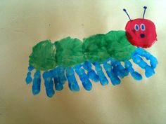 This turned out so cute! Palms green, fingers blue, paint red circle, add facial features, and volia! The Hungry Caterpillar!