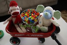 Cookies & Milk Baby Shower Party Ideas - love the radio flyer with Pink m&m's and pink stuffed animals