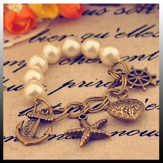 "Everything about it says ""Jersey Shore"" in the Summer Helm, Starfish, Anchor, Heart, Pearl Bracelet"