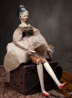 exquisite antique wooden doll