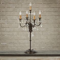 View the 5 Light Table Candelabra from Arhaus. With luxurious lighting, candelabras enhance a room with elegance. Featuring sparkling hand-cut crys