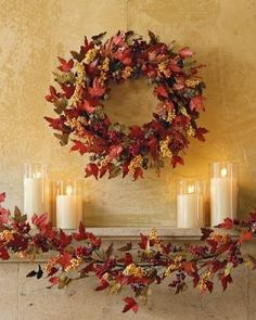 Fall Fireplace Decor: Fall leaf wreath, Glass jars with candles, and leaf garland