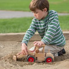 This front end loader is made by Fagus, a company renowned for its high-quality wooden trucks. Wooden Truck, Natural Toys, Toy Craft, Wood Toys, Play Houses, Children, Kids, Nova, Crafts