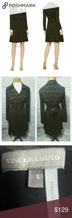 Stunning Vince Camuto Zigzag Collared Wrap Dress Women's Vince Camuto 'Empire Zigzag' Collared Wrap Dress Size Large.  Cut from soft jersey knit, a wrap dress flatters a variety of figures and offers day-to-night versatility. A spread collar tops the deep V-neckline for a touch of tailored polish, and the A-line skirt enhances the waist-nipped design.  True-wrap style with side-tie closure. V-neckline with spread collar. Long sleeves with vented cuffs. Unlined. 96% polyester, 4% spandex…