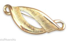 Deep grooves are accentuated in this textured gold tone brooch. Great accessory for a blazer or neck scarf. #Stuff4Uand4U