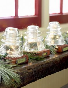 Glass insulators as mantel decor, could turn into stocking holders and paint them as snowmen, santa etc