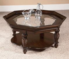Showcasing a weathered cherry finish, beveled glass top, and lower display shelf, this stately coffee table is perfect for resting an afternoon espresso or d. Cottage Furniture, Table, Brunch Table, Wynwood Furniture, Irish Cottage, Fantastic Furniture, Coffee And Cocktail Tables, Home Decor, Coffee Table