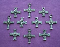Forged cross pendandts.