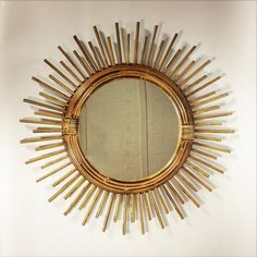 Ravishing sun shaped bamboo and rattan mirror. by LampAndCo on Etsy https://www.etsy.com/listing/243062038/ravishing-sun-shaped-bamboo-and-rattan