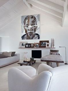 Vaulted living room ceiling with the white furnishings and contemporary art along with the ethnic accents.