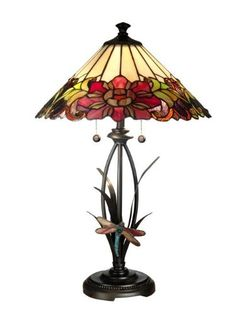 Dale Tiffany TT10793 Floral with Dragonfly Tiffany Table Lamp, Antique Bronze. Combo of flower and dragonfly in 255 pieces of art glass. Art glass in gleaming shades of red, pink, purple, and green. Cheery dragonfly on plant-like base. Lamp features a metal base with an antique bronze finish. Uses 2 60-watt bulbs.