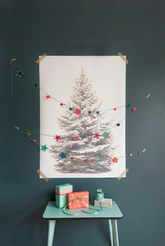 eco-friendly tree! pin up a photo of a beautiful evergreen and tack garland over it in zig-zag fashion.  place gifts beneath your tree.