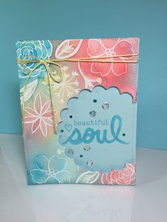 Emboss resist water color background window card.