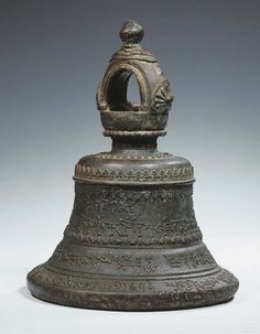 a tibetan bronze temple bell - 19th century  with various inscriptions in Tibetan dBu.can script (36cm H)