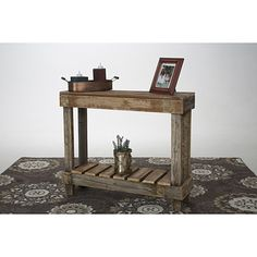 """This barnwood entry table is made from 100% reclaimed wood. The natural barnwood color may have browns, grays, reds, oranges and any other light color that comes with old wood. No assembly required.Measurements:30"""" x 36"""" x 10.5""""(height x width x depth) Country of Origin: USA"""