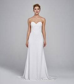 Strapless crepe chiffon Aline gown with vine and scroll embroidery appliques on bodice and train. Locate It