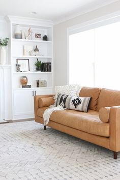 We finally decided on a new couch for the living room and are in LOVE with the one we chose. Today we are reviewing the Sven Sofa and chatting about how we plan to take care of this leather couch from Article. #leathercouch