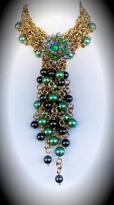 Necklace | Clovis Design Joyas.  Pearls, chain and vintage crystal pin.