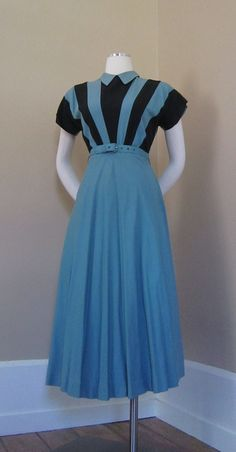 """WWII Wartime era vintage original frock, with fantastic """"V for Victory"""" inspired print! Pale shade of Airforce Blue Rayon blend, with constrasting bold black angled Colorblock design over front bodice, creating an optical perspective pattern. Back of bodice, swingy full skirt, collar & belt are all in this rich shade of blue."""