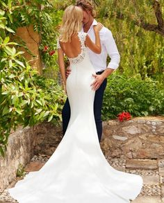 Low back, lace back wedding dress 'fiana' the White One collection by Pronovias. Gorgeous georgette fabric, with a high neckline and a beautiful low back with lace #weddingdres #bridalgown #whiteonebypronovias #beautiful #bridetobe #misstomrs #2018collection #newdress #buttonback #Georgette #highneckline