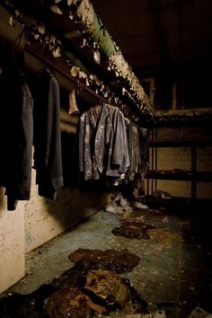 Northam Manor Psychiatric Hospital. Some old suits still hung from the basement pipes, while other damp pieces of clothing lie crumpled and rotting on the floor.