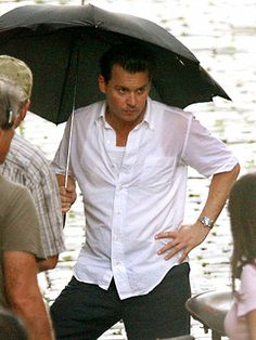 Although he has his own island in the Bahamas, Johnny Depp continues spending time in San Juan, Puerto Rico – where he braved a tropical downpour! – to film the adaptation of Hunter S. Thompson's The Rum Diary