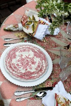 Beautiful tablescape with white charger under transferware--picking up more of a pink look with the tablecloth--spring time table?