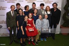 Hayden Keeler-Stone, Louis Davison, Cameron King, Raffiella Chapman, Ella Purnell, Pixie Davis, Asa Butterfield, Georgia Pemberton, Joseph Odwell, Finlay Macmillan, Tom Odwell, Lauren McCrostie and Tim Burton attend a UK Fan Screening of 'Miss Peregine's Home For Peculiar Children' at The Soho Hotel on September 16, 2016 in London, England.