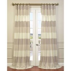 The beautiful Platinum and Pearl blackout curtain panel is crafted from luxurious faux silk and features stylish colors that are sure to add charm and elegance to your home decor.