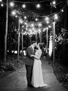 Sweet twinkling wedding portrait: http://www.stylemepretty.com/2016/02/11/classic-springtime-dunaway-gardens-wedding/   Photography: Amy Arrington - http://www.amyarrington.com/