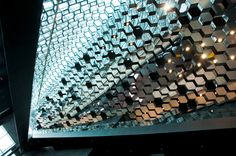 HARPA Music Hall and Conference Center in Reykjavik, Iceland features aesthetic elements throughout the building such as hexagonal mirrors on the ceiling and a glass facade representing the Icelandic basalt rock formations