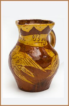 A small north Devon slipware jug with scraffito decoration displaying flowers, leaves and a bird. A very similar jug is illustrated on page 70 of 'The Potteries Museum & Art Galleries slipware collection', though without the inscription 'for a good boy'. Circa 1860         Height 5 1/2″