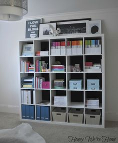 I want this bookshelf in the classroom!! A cubby for the subject per student, text books, lower shelves for organizing toys in nice baskets!!!  Fabric Lined Expedit Bookshelf