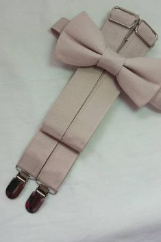 Bridal Color Nude. Suspenders and Bow Tie Set. Sizes Infant to Adult. Free Fabric Sample Available. Free Fabric Samples, Free Fabric Swatches, Color Swatches, Groomsmen Suspenders, Suspenders For Boys, Spring Wedding Colors, Summer Wedding, Ring Bearer Outfit, Wedding Bows