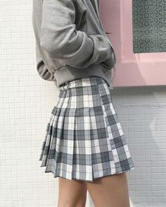 this mini skirt is similar to the 1967's green skirt because if the length and the pelted style as well as the plaid.