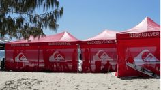 Pop up marquees with printed back walls for a sporting event.