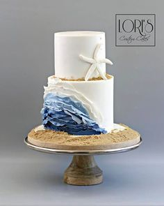 Adore this beach cake by Lori's Custom Cake!