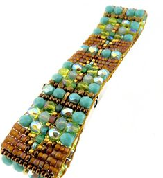 """CHILI ROSE COWBOY """"TURQUOISE In the SAND """" GEMSTONE BEADED BRACELET Adonnah Langer hand looms Czech and Japanese seed beads with Czech fire-polished and brass beads woven into spectacular intricate designs Czech Bronze Beads """"pop"""" against this simple yet gorgeous hand beaded design -Turquoise , soft irridiscent lime and golden bronze are the gorgeous colors that will look amazing against your wrist- great alone or layered! -The end caps and clasp are all set sterling silver .925 with…"""